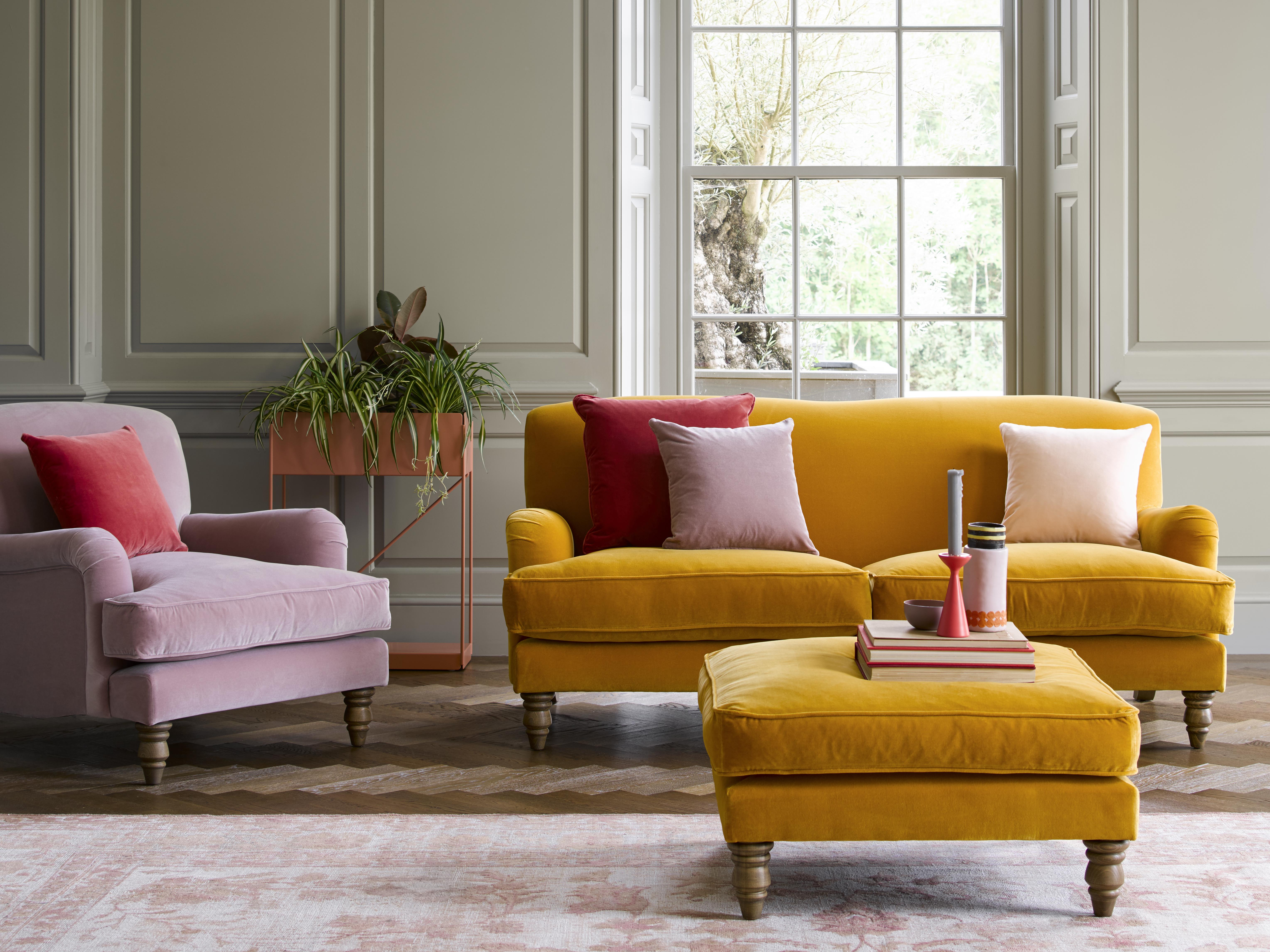 pink armchair, yellow sofa and footstool